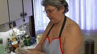 Horny granny plays with her pussy