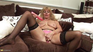 Naughty blonde lady playing with a dildo