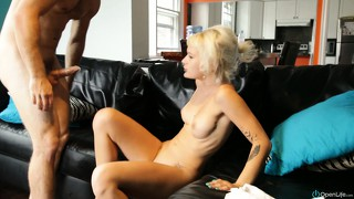 Giving cute blond model a good ride on top of a leather couch