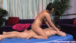 She rubs her body and teases his prick and then jacks him off