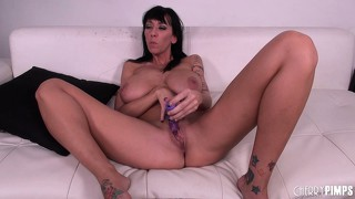 She pleases her twat with a dildo when a cock shows up and she sucks it with joy