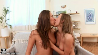 Gorgeous lesbian beauties use a sex toy on each other's pussy
