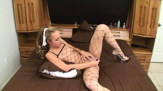 Slender blonde in fishnet outfit penelope enjoys her time with a sex toy