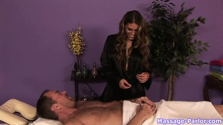 Sexy brunette masseuse uses her hands and lips to massage his dick