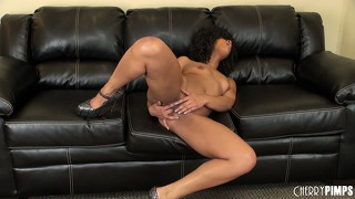 Misty rubs her clitoris on the couch and starts toying her hole