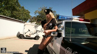 Horny cop babe gets her rubber club nice and wet for her cunt