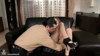 She gives him a sensual blowjob before he licks and fucks her twat on the sofa