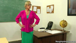 Professor brandi love is a slutty cougar that has a crush on student guy xander corvus. four-eyed lady with huge fake tits and round ass does striptease in front of him in the classroom and then takes his dick in her vagina from behind.