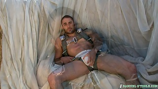 Samuel shows off his hot package in a jockstrap on the set
