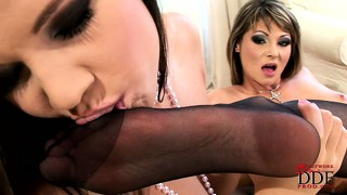 Cougar scissors with her girlfriend before teasing her  feet