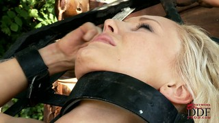 Redheaded dominatrix ties up her slave outside and tortures her