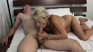 Granny couldn't keep her hands off his young body in the parking lot and fucks him hard at home