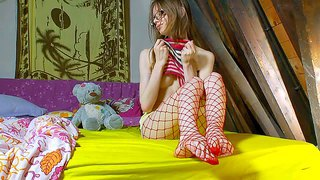 Gloria is s skinny pale skinned girl with pretty small tits. four-eyed cutie poses topless in the bedroom with her fishnet pantyhose and tight panties on. watch flirty teen girl pose on cam.