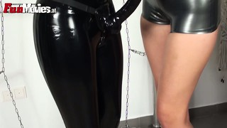 Latex clad bitch has a face dildo and it gets sucked and sat on