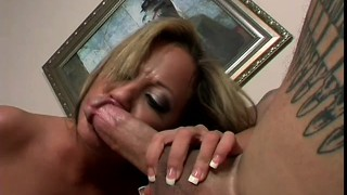 The busty blonde gets on top of him and his long cock deeply invades her tight holes