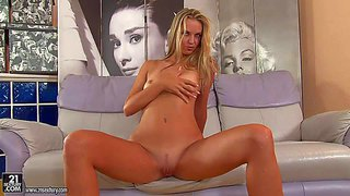 Anita is a really beautiful young blond babe with perky tits and pink pussy. she parts her legs on the couch and then inserts four fingers in her love hole. watch mouth-watering anita play with herself.