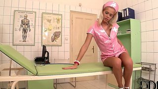 Nurse tracy gold, clad in pink dress, acts very strangely as if her pussy grows very wet