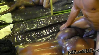 Oiled black ass hard fucked by a dick