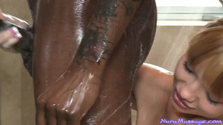 Hung black man getting his cock serviced by a slutty white masseuse