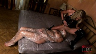 Slave bound in saran wrap gets paddled and teased by her mistress