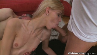 The slim blonde fully enjoys the hot threesome and takes their cum on her tits