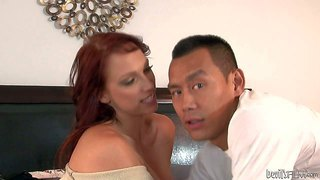 Nikki hunter is a hot blooded redhead milf who can't keep her mouth off sweet young asian cock. she gives throat job to hot boy and then opens her legs. he licks milf's pink shaved pussy willingly.