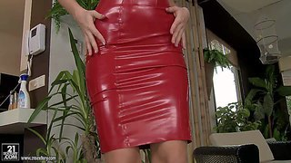 Tall blonde babe karina shay in black shoes and red pleather dress bares her juicy tits in front of black guy in the middle of the room. he can't keep his lips and hands off her titties.