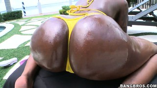 With the sun on her skin, the ebony girl displays her perky tits, sexy ass and pink twat
