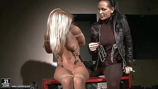 Young blonde bitch nikky thorne with big juicy tits gets tied up naked and dominated by black haired busty milf with long hair and ponytail in black leather jacket