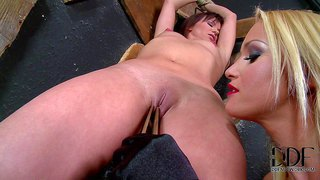 Naked redheaded slave girl alysa with sexy nicely shaped ass gets her smooth pussy ruthlessly tortured by glammed up blond-haired dominatrix kathia nobili in the dungeon. enjoy!