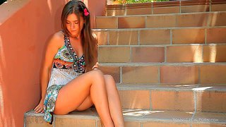 Guerlain is a 18 year old cutie with charming smile. flirty girl takes off her summer dress outdoors on the stairs. topless girl with perky tits poses sexy in her black panties.