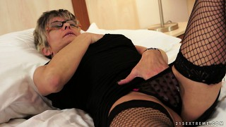 Granny's afternoon hobby is wearing sexy lingerie and finger banging herself