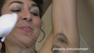 Kitty cleans her hairy pussy in the shower