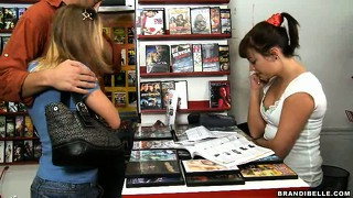 Sexy blonde and naughty brunette suck a nice big dick in a video store