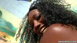 Attractive turned on curly black whore nyomi banxxx with massive fake melons and huge firm ass get oiled and naked and polishes her shaved cunt with hitachi vibrator in close up